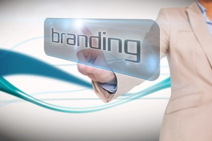 Businesswoman pointing to word branding