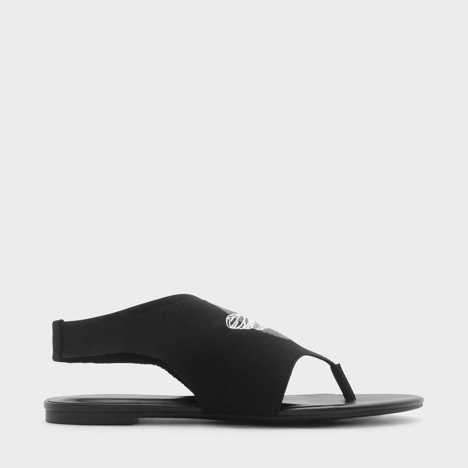 20c2e7073f65f CHARLES   KEITH – Shoes. Black thong sandals featuring an embroidered  detail and a sling back design.