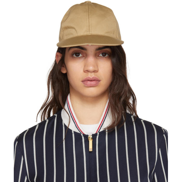 b4910578970 High density cotton twill six-panel cap in khaki. Eyelet vents at sides.  Signature tricolor cinch strap at back. Antiqued silver-tone hardware.